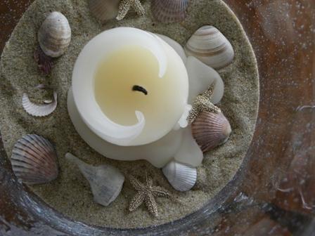 Unlit candle in bubble vase