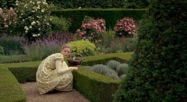 Emma in herb garden 1