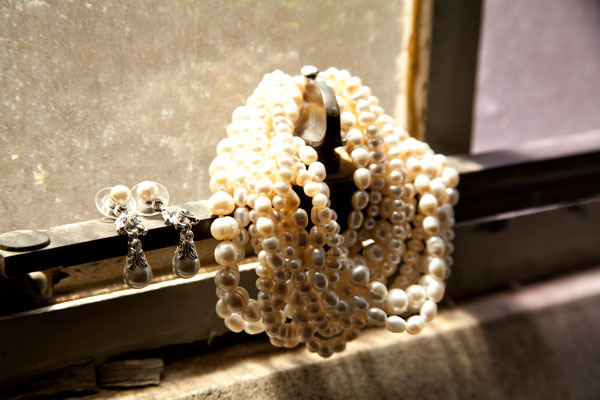 Wedding jewelry on window sill