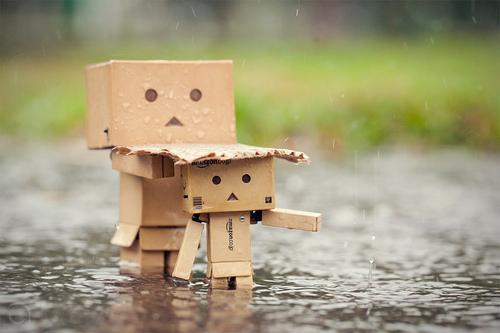 Garage cardboard boxes in the rain