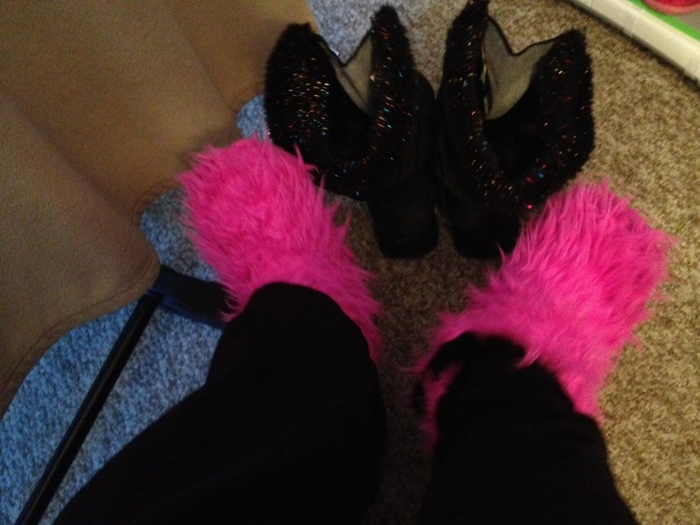 Fuzzy pink slippers after snow boots